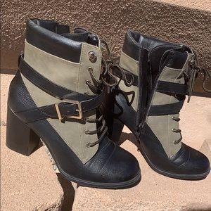 High heeled combat boots.